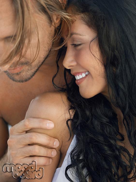 Couple embracing close up