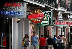 11june 2010. New Orleans, Louisiana. <br /> Signs advertising everything from seafood to bars and more along Bourbon Street in the French Quarter. Worries persist as fish stocks run low and prices rise thanks to closed fishing grounds affected by oil pollution. BP's disastrous environmental catastrophe out in the Gulf of Mexico threatens  the livelihood of many thousands of workers affiliated to the fishing industry in Louisiana. Thousands of barrels of oil per day continues to leak into the Gulf because of the explosion and collapse of the Deepwater Horizon drilling platform 46 miles out to sea. The closure of fishing grounds both east and west of the Mississippi river outflow is crippling thousands of local fishermen and all affiliated businesses and families who rely on the seafood industry.  <br /> Photo; Charlie Varley/varleypix.com