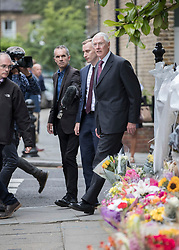 © Licensed to London News Pictures. 29/06/2017. London, UK. Retired Court of Appeal judge Sir Martin Moore-Bick (R) is questioned by reporters as he passes floral tributes at St Clements Church after meeting with Grenfell fire survivors. He has been chosen to lead the public inquiry into the Grenfell Tower fire. Photo credit: Peter Macdiarmid/LNP