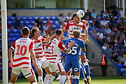 Doncaster Rovers defender Andrew Butler(6) clears this cross during the EFL Sky Bet League 1 match between Peterborough United and Doncaster Rovers at London Road, Peterborough, England on 1 September 2018.