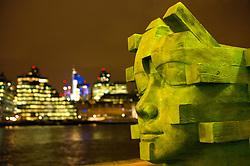 UK ENGLAND LONDON 1DEC11 - A wooden sculpture in front of the City of London skyline graces the Thames River path near London Bridge, Southwark, London.....jre/Photo by Jiri Rezac....© Jiri Rezac 2011