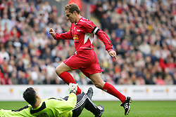 LIVERPOOL, ENGLAND - SUNDAY MARCH 27th 2005: Liverpool Legends' Jason McAteer beats Celebrity XI's Eric Nixon during the Tsunami Soccer Aid match at Anfield. (Pic by David Rawcliffe/Propaganda)