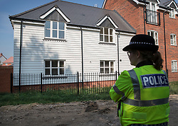 © Licensed to London News Pictures. 04/07/2018. Amesbury, UK. A police officer stands at the rear of a property in Muggleton Road, Amesbury after a couple named locally as Dawn Sturgess, 44, and her partner Charlie Rowley, 45, were taken ill on Saturday 30th June 2018. Police have confirmed that the couple have been in contact with Novichok nerve agent. Former Russian spy Sergei Skripal and his daughter Yulia were poisoned with Novichok nerve agent in nearby Salisbury in March 2018.Photo credit: Peter Macdiarmid/LNP