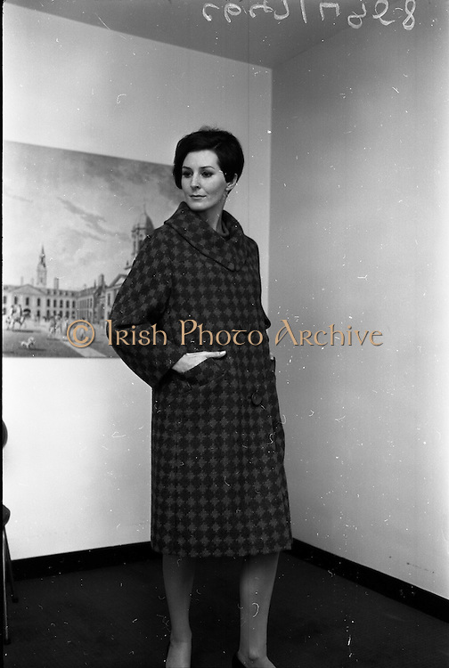 "18/04/1966<br /> 04/18/1966<br /> 18 April 1966<br /> Stands and Models at the 3rd Irish Export Fashion Fair at the Intercontinental Hotel, Dublin. Model wearing ""Shandon"" a red and green and check coat by Elizabeth James of Cork."