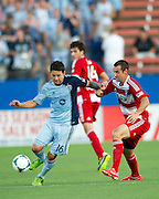 FRISCO, TX - JUNE 22:  Claudio Bieler #16 of Sporting Kansas City battles against Andrew Jacobson #4 of FC Dallas on June 22, 2013 at FC Dallas Stadium in Frisco, Texas.  (Photo by Cooper Neill/Getty Images) *** Local Caption *** Claudio Bieler; Andrew Jacobson