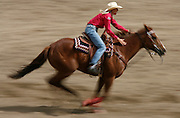 061508-Evergreen, CO-barrellracing-Barrel racer Shali Lord drives her horse towards the finish during the barrel racing competition Sunday, June 15, 2008 at the Evergreen Rodeo Grounds..Photo By Matthew Jonas/Evergreen Newspapers/Photo Editor