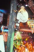 A dancer climbing the beams at Cream, Ibiza 1998