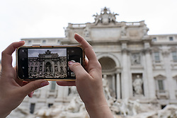 May 25, 2019 - Rome, Italy - A tourist takes a photo of Trevi Fountain with their iPhone camera on May 25, 2019 in Rome, Italy. (Credit Image: © Alex Edelman/ZUMA Wire)