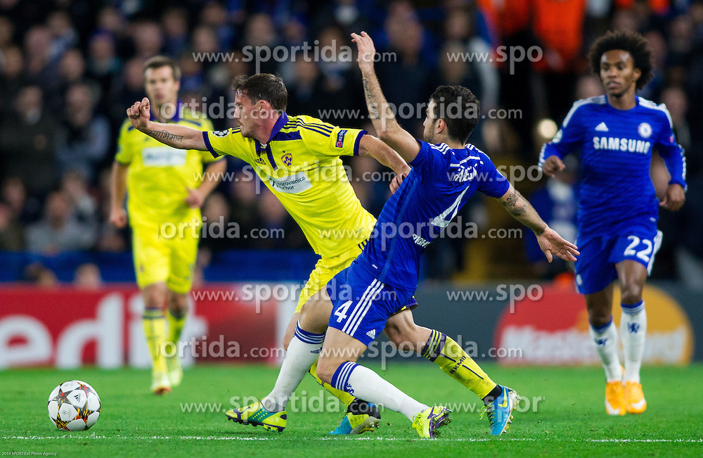 Ales Mejac of Maribor faulted by Cesc Fàbregas of Chelsea during football match between Chelsea FC and NK Maribor, SLO in Group G of Group Stage of UEFA Champions League 2014/15, on October 21, 2014 in Stamford Bridge Stadium, London, Great Britain. Photo by Vid Ponikvar / Sportida.com
