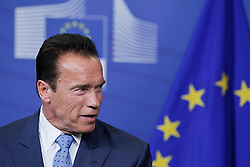 59895735<br /> U.S. actor and former Governor of California Arnold Schwarzenegger attends a press conference with European Commission President Jose Manuel Barroso (not seen) after their meeting at the European Union headquarters in Brussels, capital of Belgium, on June 24, 2013. They talked about climate change during their meeting on Monday  June 24, 2013. Picture by imago / i-Images<br /> UK ONLY