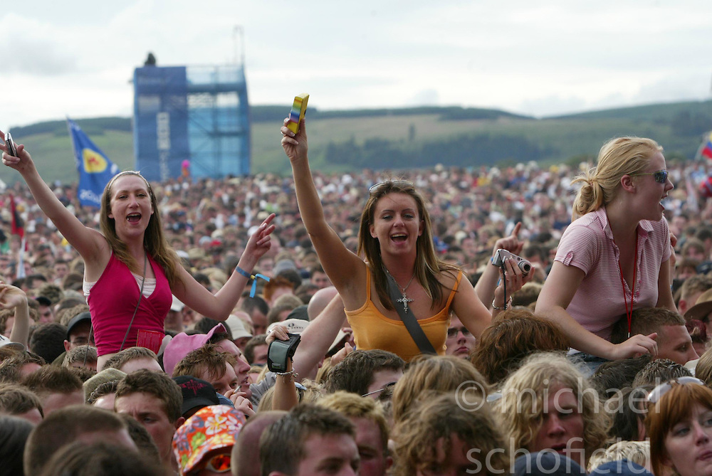 Fans in the crowd at the main stage on Saturday 10th July, 2005 at the two-day T in the Park festival, at Balado, Kinross-shire, Scotland..