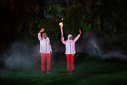 JAKARTA, Aug. 18, 2018  Torch bearers hand over the torch during the opening ceremony of the 18th Asian Games at the Gelora Bung Karno (GBK) Main Stadium in Jakarta, Indonesia, Aug. 18, 2018. (Credit Image: © Cheong Kam Ka/Xinhua via ZUMA Wire)