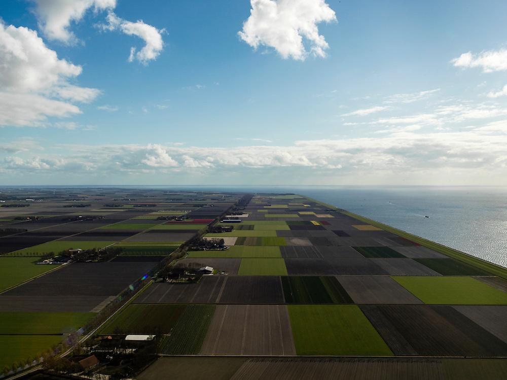 Nederland, Flevoland, Noordoostpolder, 16-04-2012; Noordermeerweg, overzicht van de polder met rechts het IJsselmeer. Voorbeeld van moderne grootschalige polder met rationele verkaveling. De aanleg van de polder maakte deel uit van de Zuiderzeewerken (plan Lely) en viel in 1942 droog. De meeste boerderijen (en dorpen) zijn van na de tweede wereldoorlog. The northeast polder (NOP), is an example of modern large-scale polder with rational allotment. The construction of the polder was part of the Zuiderzee Works (Lely plan), in 1942 the polder was dry. Most of the building, farmhouses and villages, is post-war...QQQ.luchtfoto (toeslag), aerial photo (additional fee required).foto/photo Siebe Swart