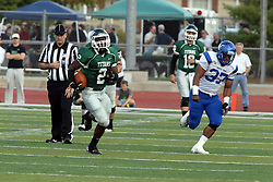 12 October 2013:  Devonte Jones finds a huge hole in the middle then heads for the sidelines tailed by Darius Dacany during an NCAA division 3 football game between the North Park vikings and the Illinois Wesleyan Titans in Tucci Stadium on Wilder Field, Bloomington IL