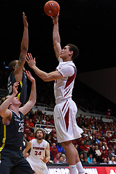 Feb 19, 2012; Stanford CA, USA; Stanford Cardinal forward Dwight Powell (33) shots over Oregon Ducks center Tony Woods (55) during the first half at Maples Pavilion.  Mandatory Credit: Jason O. Watson-US PRESSWIRE