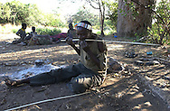 Yaeda Valley, Tanzania: Gonga Gonga, a Hadzabe man, straightens an arrow by using the heat of a fire, and his teeth. The Hadzabe are one of the last tribes of hunter gatherers on earth, and practice a culture that has changed relatively little in 60,000 to 90,000 years. (PHOTO: MIGUEL JUAREZ LUGO)