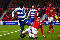 Joe Lolley of Nottingham Forest slides in to tackle Eberechi Eze of Queens Park Rangers - Mandatory by-line: Ryan Crockett/JMP - 22/02/2020 - FOOTBALL - The City Ground - Nottingham, England - Nottingham Forest v Queens Park Rangers - Sky Bet Championship