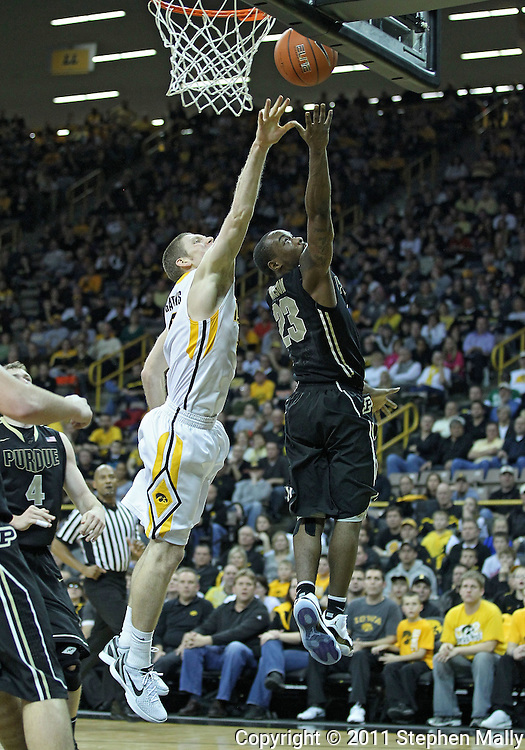 December 28, 2011: Purdue Boilermakers guard Lewis Jackson (23) puts up a shot past Iowa Hawkeyes guard Matt Gatens (5) during the NCAA basketball game between the Purdue Boilermakers and the Iowa Hawkeyes at Carver-Hawkeye Arena in Iowa City, Iowa on Wednesday, December 28, 2011. Purdue defeated Iowa 79-76.