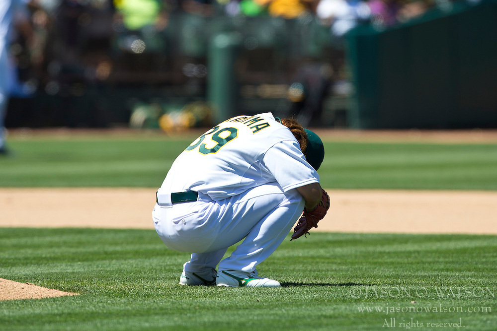 OAKLAND, CA - MAY 19: Hideki Okajima #39 of the Oakland Athletics kneels behind the pitcher's mound before pitching against the Kansas City Royals during the seventh inning at O.co Coliseum on May 19, 2013 in Oakland, California. The Oakland Athletics defeated the Kansas City Royals 4-3. (Photo by Jason O. Watson/Getty Images) *** Local Caption *** Hideki Okajima
