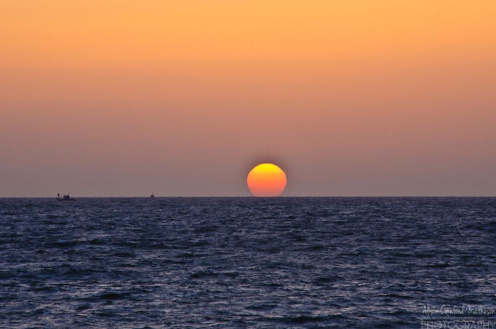 Sunset over Candolim Beach, Goa, India. Candolim beach is a popular holiday destination on the Indian coast.