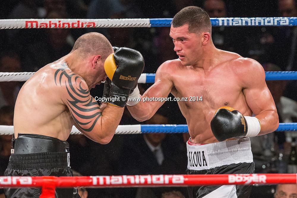 David Aloua (R) fights Anthony McCracken in the Mahindra Super 8 Fight Night, North Shore Events Centre, Auckland, New Zealand, Saturday, November 22, 2014. Photo: David Rowland/Photosport