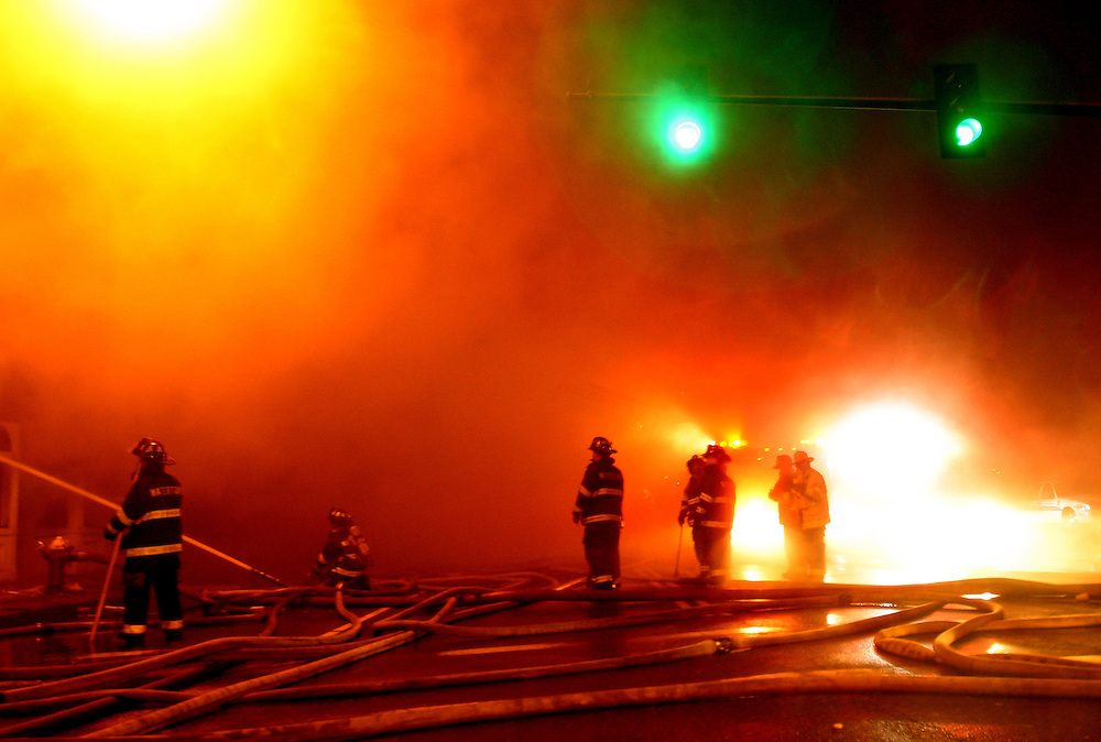 Fire crews fight a four alarm blaze on Galen St., Watertown, MA, February 23, 2005.  The fire, which began in a basement at about 10:30 pm, destroyed a block of stores.