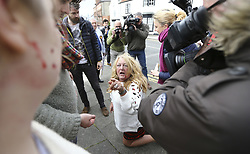 April 29, 2017 - Hartlepool, County Durham, UK - Hartlepool UK. A UKIP supporter kneeling on the floor with blood on her face after a fight breaks out between Pro EU campaigners North East for Europe and UKIP party supporters in Hartlepool, County Durham, before UKIP leader Paul Nuttall heads out on the campaign trail. (Credit Image: © Andrew Mccaren/London News Pictures via ZUMA Wire)