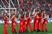 """The Independiente """"Red Devils"""" cheerleaders strut their stuff before a game. The Red Devils are rivals with the Boca Juniors Cheerleaders. Sept 2005."""