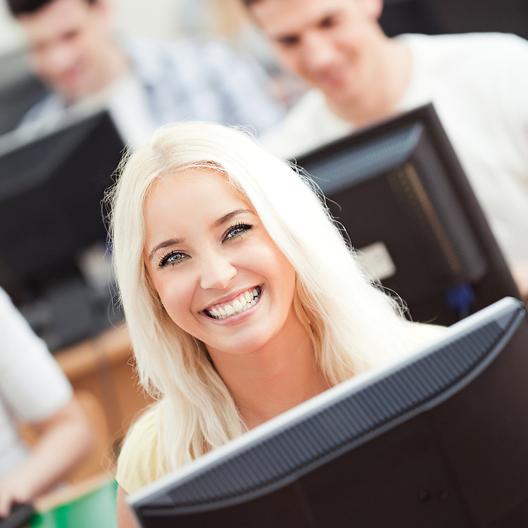 Portrait of a smiling student in computer science class.