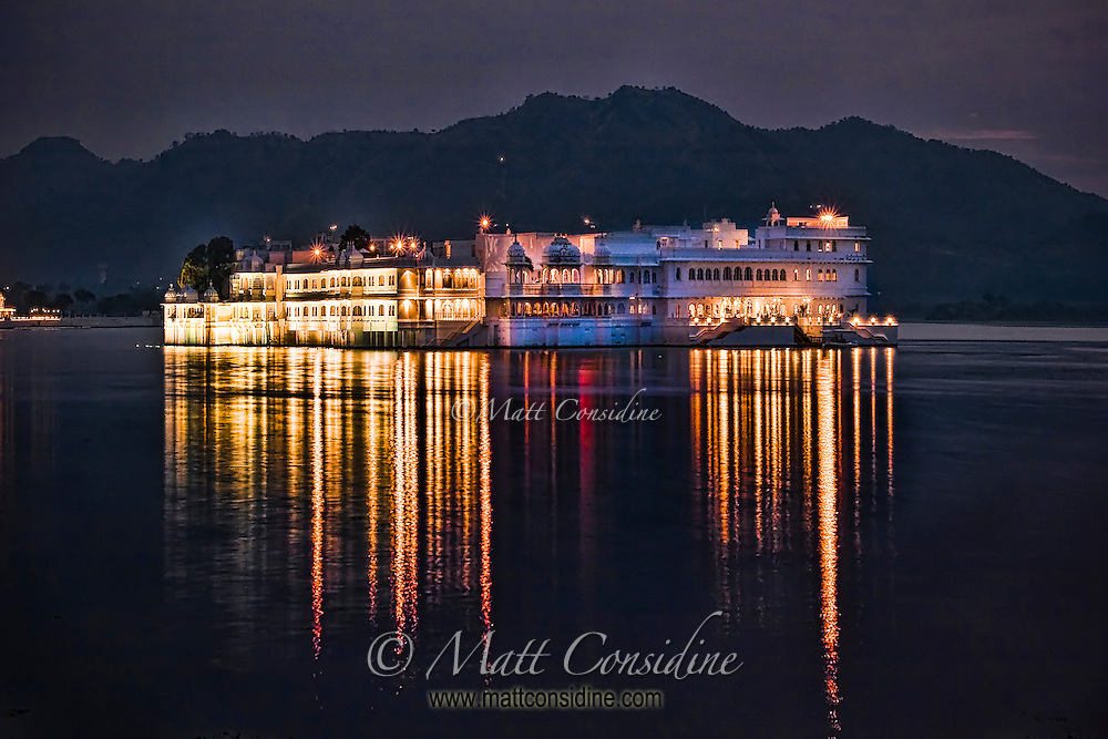 Lovely reflection of the Taj Lake Palace lights in the waters of Lake Pichola at twilight.<br /> (Photo by Matt Considine - Images of Asia Collection)