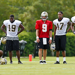 July 29, 2011; Metairie, LA, USA; New Orleans Saints quarterback Drew Brees (9) stands with wide receivers Adrian Arrington (left), John Chiles (11), Devery Henderson (19), Robert Meachem (17), and Marques Colston (12)during the first day of training camp at the New Orleans Saints practice facility. Mandatory Credit: Derick E. Hingle