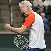 March 1, 2014, Indian Wells, California: <br /> John McEnroe reacts after winning a point during the McEnroe Challenge for Charity presented by Esurance in Stadium 2 at the Indian Wells Tennis Garden. <br /> (Photo by Billie Weiss/BNP Paribas Open)