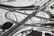 Nederland, Utrecht, Oudenrijn, 31-01-2010; knoopppunt Oudenrijn in de sneeuw, diagonaal van linksonder naar rechtsboven de A2 richting  Amsterdam, de A2 kruist de A12<br /> Oudenrijn junction<br /> luchtfoto (toeslag), aerial photo (additional fee required)<br /> foto/photo Siebe Swart