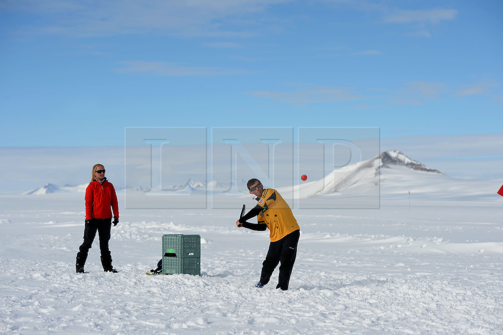 "© Licensed to London News Pictures. Union Glacier, Antarctica. PETER JOUBERT resident of Perth, Australia batting. Competitors from the Antarctic Ice Marathon play a game of impromptu ""Ashes"" cricket at the Union Glacier camp, Antarctica ahead of the 2013 Antarctic Ice Marathon, which takes place  just a few hundred miles from the South Pole at the foot of the Ellsworth Mountains.. The majority of players were either Australian and English. It was declared a sporting draw. Photo credit: Mike King/LNP"