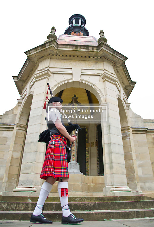Former sergent major Piper Scott Johnstone played a lament at the Peebles cenotaph in memory of Alex Lucas who was killed on 4 June 2008 in Afghanistan. The cenotaph commemorate those from Peebles who were killed in action in the service of their country<br /> <br /> (c) Ger Harley | Edinburgh Elite media