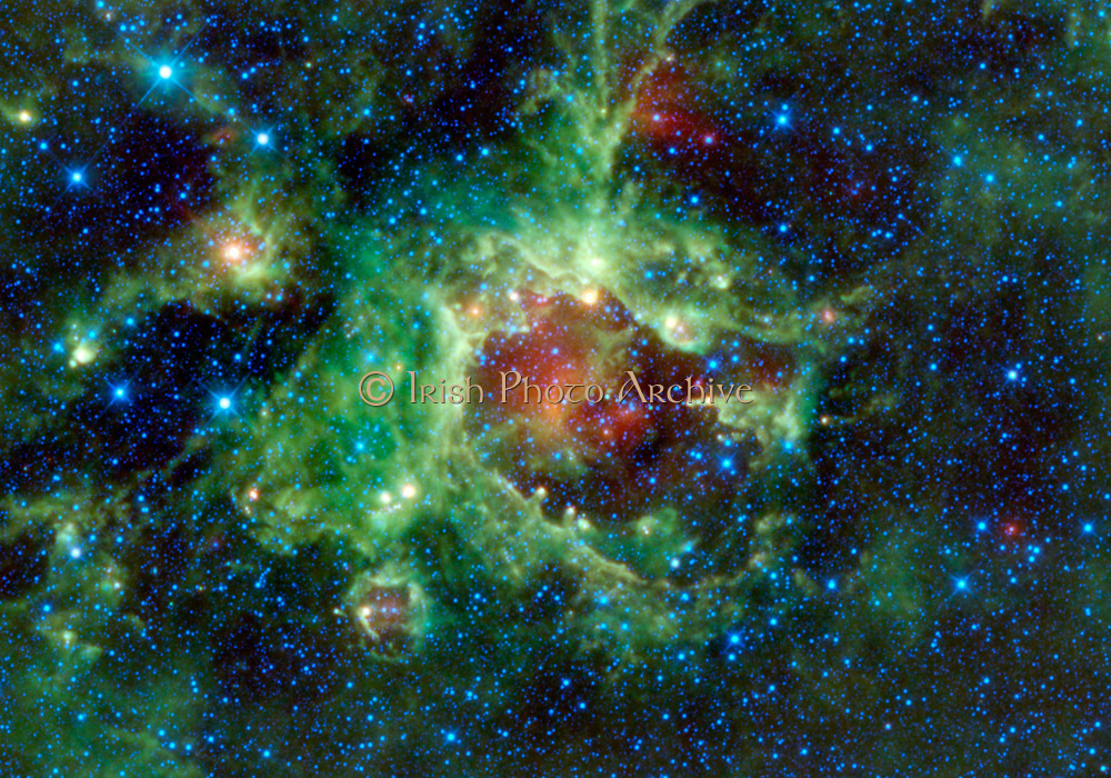 NASA's Wide-field Infrared Survey Explorer, or WISE, captured this image of a star-forming cloud of dust and gas located in the constellation of Monoceros. The nebula, commonly referred to as Sh2-284, is relatively isolated at the very end of an outer spiral arm of our Milky Way galaxy. In the night sky, it's located in the opposite direction from the centre of the Milky Way. Perhaps the most interesting features in Sh2-284 are what astronomer call 'elephant trunks.' Elephant trunks are monstrous pillars of dense gas and dust. The most famous examples of are the 'Pillars of Creation,' found in an iconic image of the Eagle nebula from NASA's Hubble Space Telescope. In this WISE image, the trunks are seen as small columns of gas stretching towards the centre of the void in Sh2-284, like little green fingers with yellow fingernails. The most notable one can be seen on the right side of the void at about the 3 o'clock position. It appears as a closed hand with a finger pointing towards the centre of the void. That elephant trunk is about 7 light-years long. Deep inside Sh2-284 resides an open star cluster, called Dolidze 25, which is emitting vast amounts of radiation in all directions, along with stellar winds. The colours used in this image represent specific wavelengths of infrared light. Blue and cyan (blue-green) represent light emitted at wavelengths of 3.4 and 4.6 microns, which is predominantly from stars. Green and red represent light from 12 and 22 microns, respectively, which is mostly emitted by dust.