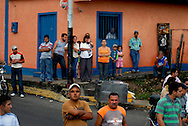 Spectators watch stage eight of the annual Vuelta al Tachira cycling race in Carbonera, Venezuela on Saturday, Jan. 12, 2008.  Local and international teams will ride over 1580 kilometers and climb a 1500 meter altitude differential throughout the competition. The grueling, 13-stage race through the Andes mountains is hailed as the premier cycling event in South America. ..