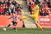 Jack Munns and Matthew Robinson during the Vanarama National League match between Cheltenham Town and Woking at Whaddon Road, Cheltenham, England on 12 March 2016. Photo by Antony Thompson.