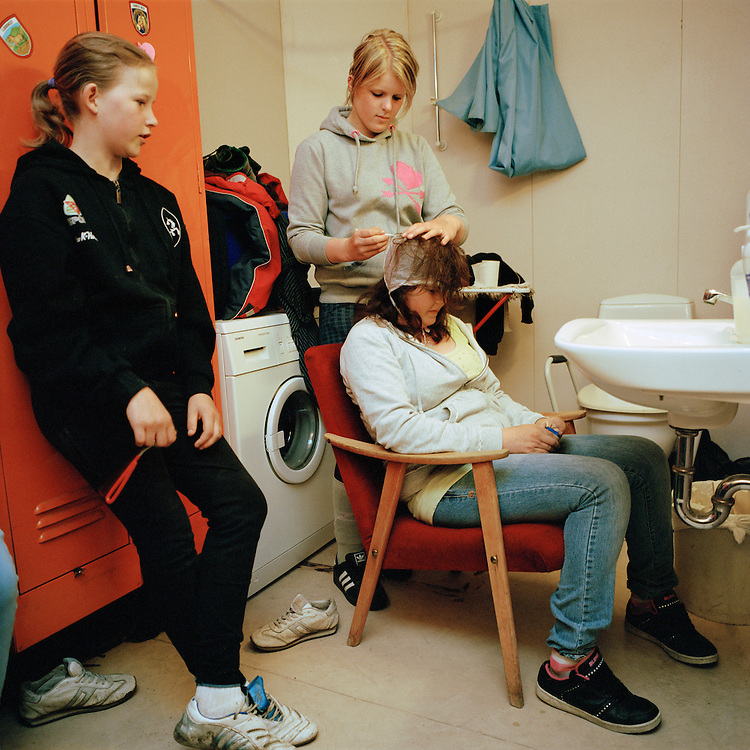 Teenage girls dying hair at Raad, Norway. Raad means advice. ..Photo by Knut Egil Wang /MOMENT