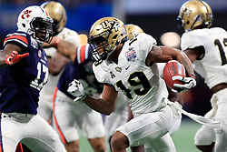 UCF Knights quarterback Sean Pratt (19) returns a kick off during the 2018 Chick-fil-A Peach Bowl NCAA football game against the Auburn Tigers on Monday, January 1, 2018 in Atlanta. (Paul Abell / Abell Images for the Chick-fil-A Peach Bowl)