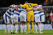 Queens Park Rangers players huddle before the EFL Sky Bet Championship match between Queens Park Rangers and Brentford at the Loftus Road Stadium, London, England on 10 November 2018.
