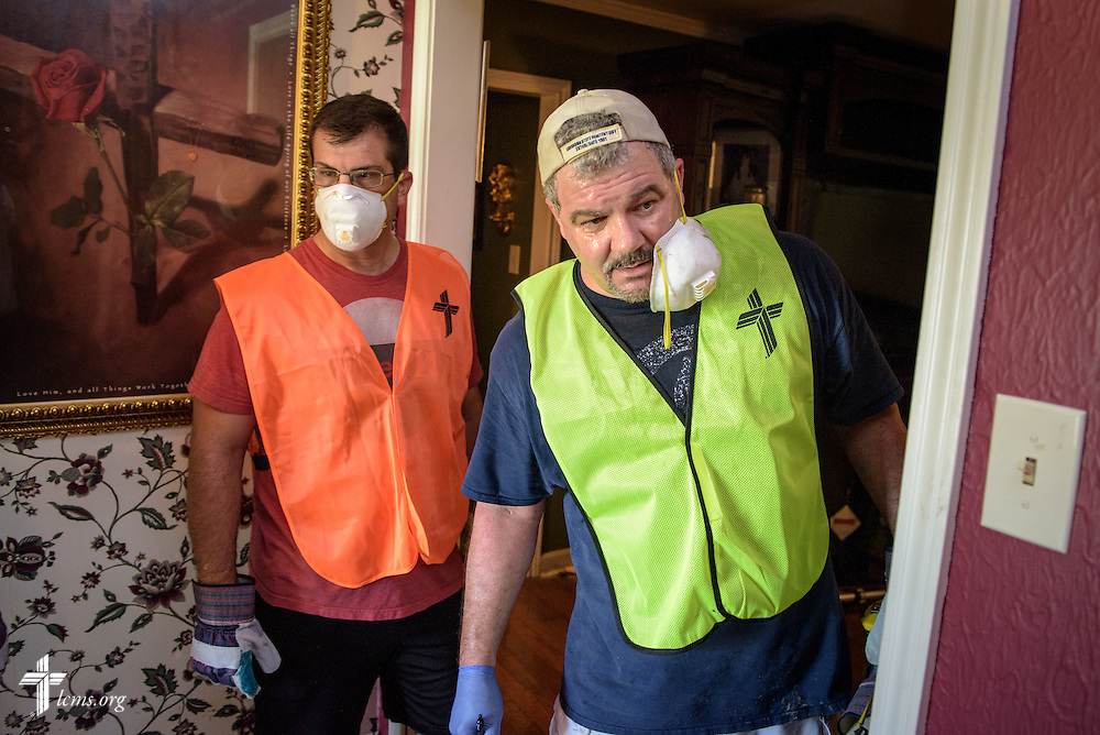 Volunteer Don Teijelo of New Orleans, and the Rev. Ross Johnson (left), director of LCMS Disaster Response, assess muck-out efforts in a flood-damaged home on Wednesday, Sept. 14, 2016, in Baton Rouge, La.  LCMS Communications/Erik M. Lunsford