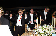 Sir Elton John, Neil Tennant and Jay Jopling, Sir Elton John's White Tie and Tiara Ball. Windsor, 28 June 2003. © Copyright Photograph by Dafydd Jones 66 Stockwell Park Rd. London SW9 0DA Tel 020 7733 0108 www.dafjones.com