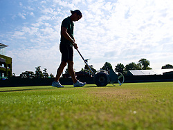 LONDON, ENGLAND - Monday, July 9, 2018: The Ground staff paint the lines as they prepare the courts on day seven of the Wimbledon Lawn Tennis Championships at the All England Lawn Tennis and Croquet Club. (Pic by Kirsten Holst/Propaganda)