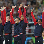 Gymnastics - Olympics: Day 4   The United States team of Alexandra Raisman, Madison Kocian, Lauren Hernandez, Gabrielle Douglas and Simone Biles on the podium to receive their gold medals after the United States team won the Artistic Gymnastics Women's Team Final at the Rio Olympic Arena on August 9, 2016 in Rio de Janeiro, Brazil. (Photo by Tim Clayton/Corbis via Getty Images)