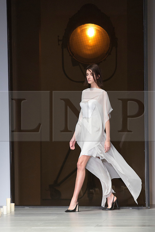 © Licensed to London News Pictures. 16 February 2014, London, England, UK. A model walks the runway at the Marios Schwab show during London Fashion Week AW14 at the BFC Courtyard Show Space/Somerset House. Photo credit: Bettina Strenske/LNP