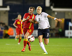 LONDON, ENGLAND - Saturday, October 26, 2013: Wales' Helen Ward (nee Lander) in action against England's Steph Houghton during the FIFA Women's World Cup Canada 2015 Qualifying Group 6 match at the New Den. (Pic by David Rawcliffe/Propaganda)