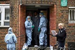 © Licensed to London News Pictures. 19/05/2016. London, UK. A police forensics team at the entrance to a property at the Maitland Park Estate in Hampstead, North London, where the body of a woman in her 40s was found.   A murder investigation has been launched. Photo credit: Ben Cawthra/LNP