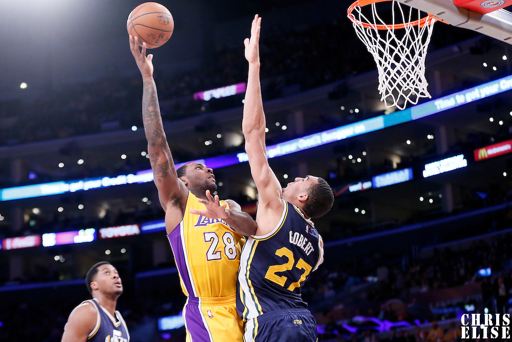 19 March 2015: Los Angeles Lakers forward Tarik Black (28) goes for the sky hook over Utah Jazz center Rudy Gobert (27) during the Utah Jazz 80-73 victory over the Los Angeles Lakers, at the Staples Center, Los Angeles, California, USA.
