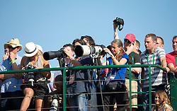 LONDON, ENGLAND - Wednesday, June 23, 2010: Fans a media crowd around the broadcast centre roof to watch the record-breaking marathon Gentlemen's Singles 1st Round match, which ended due to bad light at 59-59 in the fifth set, on day three of the Wimbledon Lawn Tennis Championships at the All England Lawn Tennis and Croquet Club. (Pic by David Rawcliffe/Propaganda)
